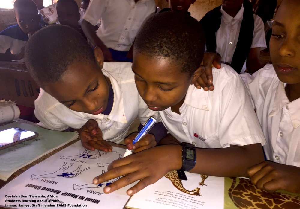 TEACHING CHILDREN AND ADULTS ABOUT WILDLIFE AND WILDLIFE CONSERVATION IS AN IMPORTANT PART OF SUSTAINABLE CONSERVATION. IMAGE: TAKEN BY PAMS STAFF MEMBER, JAMES. FROM THE PAMS FOUNDATION FACEBOOK PAGE.