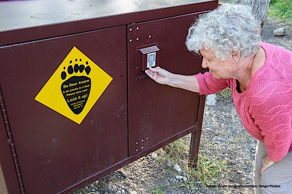 EDUCATION AND PREPARATION ARE KEY FOR WILDLIFE / HUMAN COEXISTENCE .. BOTH YELLOWSTONE AND GRAND TETON NATIONAL PARKS HAVE WILDLIFE SAFETY REMINDERS THROUGHOUT. THIS IS A SPECIAL BEAR-PROOF LOCK BOX FOR CAMPERS' FOOD AND SUPPLIES. IMAGE: Jorn Vangoidtsenhoven, Vango Photos