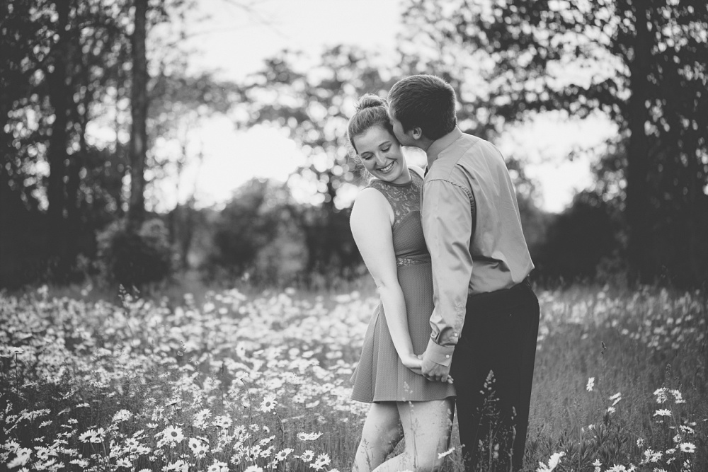 Outdoor, Summertime, dating couple session with Amber Langerud Photography | Audubon, MN field of daisies