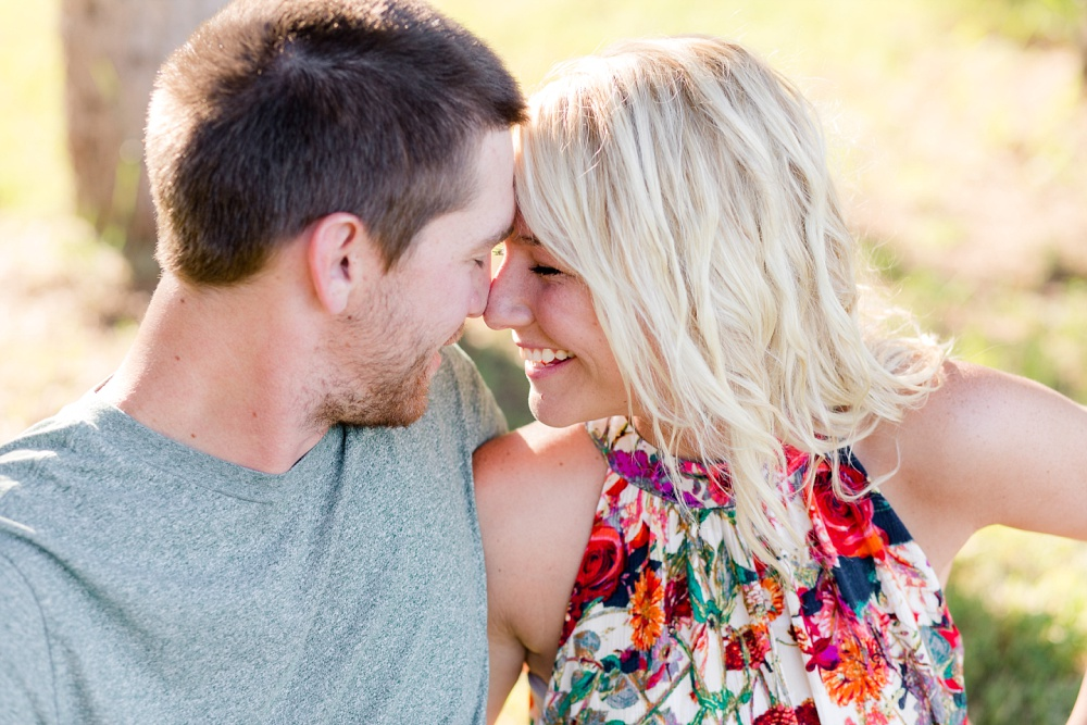 Outdoor, Country Styled Engagement Session with Their Puppy near Audubon, MN | Amber Langerud Photography | Noses Together