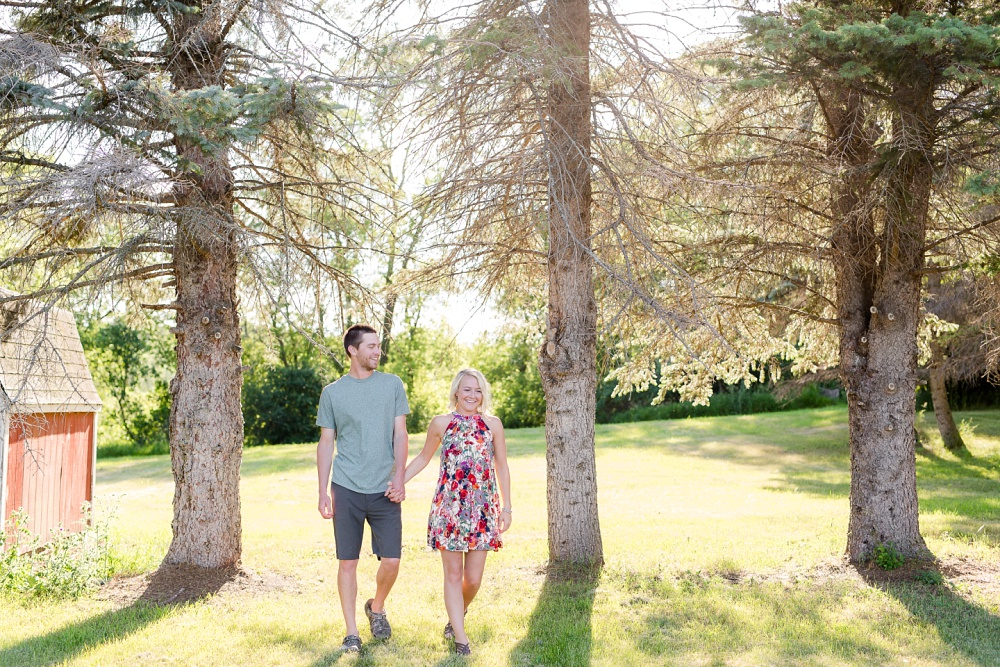Outdoor, Country Styled Engagement Session with Their Puppy near Audubon, MN | Amber Langerud Photography | Walking Photo