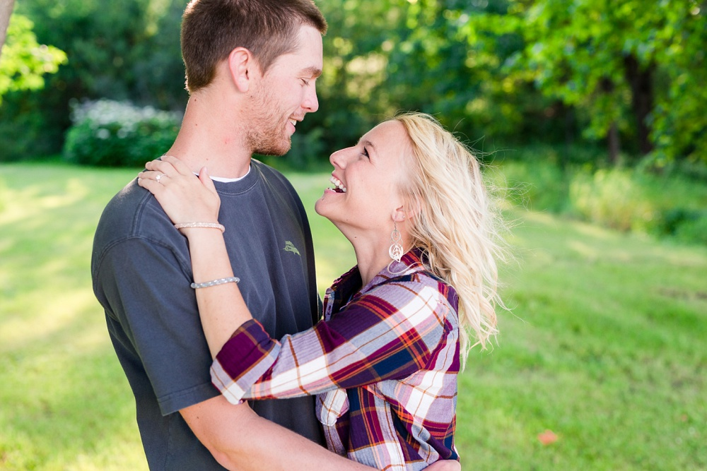 Outdoor, Country Styled Engagement Session with Their Puppy near Audubon, MN | Amber Langerud Photography | Engagement photo looking at each other