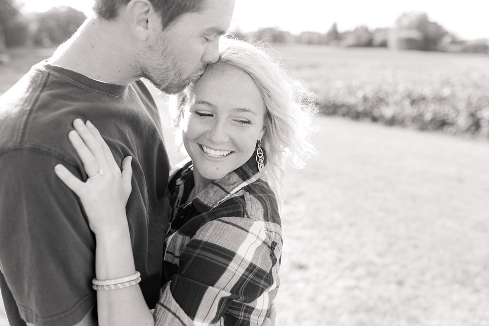 Outdoor, Country Styled Engagement Session with Their Puppy near Audubon, MN | Amber Langerud Photography | Bride to be looking away
