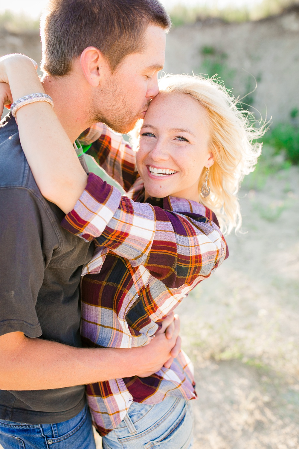 Outdoor, Country Styled Engagement Session with Their Puppy near Audubon, MN | Amber Langerud Photography | Couple holding each other