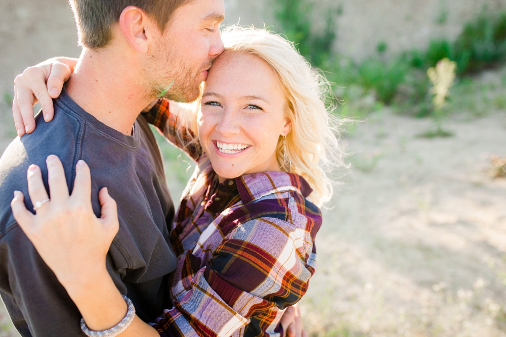 Outdoor, Country Styled Engagement Session with Their Puppy near Audubon, MN | Amber Langerud Photography | Kissing her on her forehead