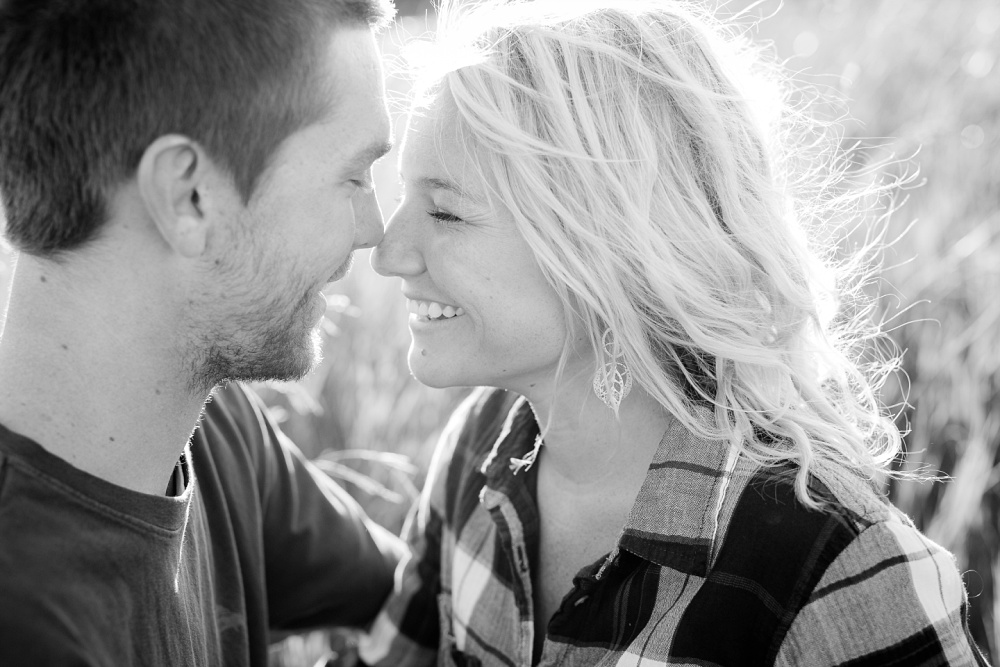 Outdoor, Country Styled Engagement Session with Their Puppy near Audubon, MN | Amber Langerud Photography | Couple's faces together