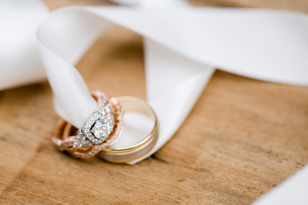 Wolf Lake, MN Country Styled Wedding, White Dress, Blue Suite | Photographed by Amber Langerud Photography | Wedding Rings on Silk Ribbon