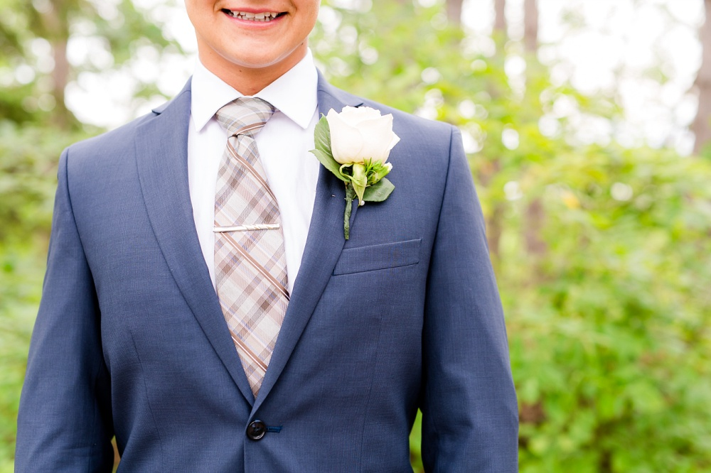 Wolf Lake, MN Country Styled Wedding, White Dress, Blue Suite | Photographed by Amber Langerud Photography | Close Up of Groom's Boutonniere