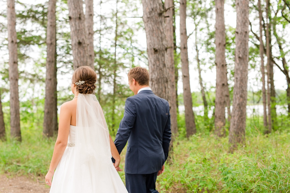 Wolf Lake, MN Country Styled Wedding, White Dress, Blue Suite | Photographed by Amber Langerud Photography | Bride & Groom Walking