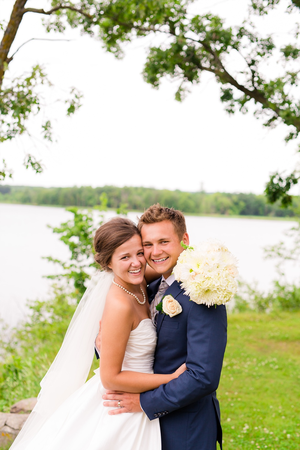 Wolf Lake, MN Country Styled Wedding, White Dress, Blue Suite | Photographed by Amber Langerud Photography | Bride & Groom by Lake