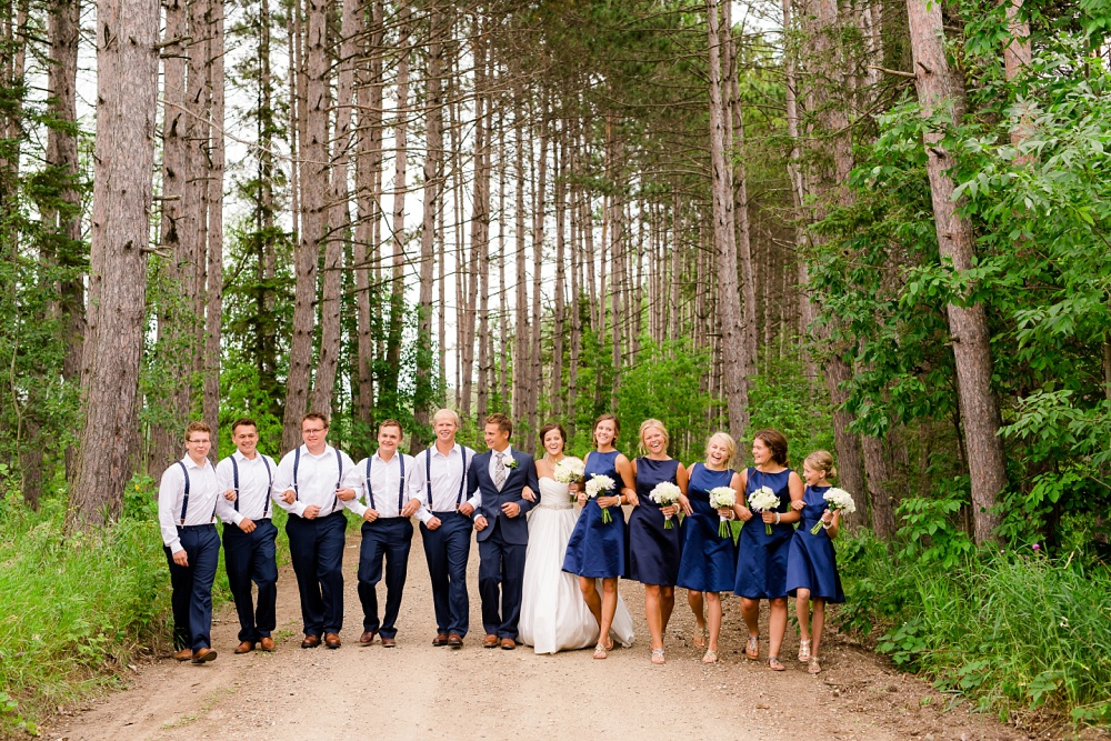 Wolf Lake, MN Country Styled Wedding, White Dress, Blue Suite | Photographed by Amber Langerud Photography | Bridal Party Walking