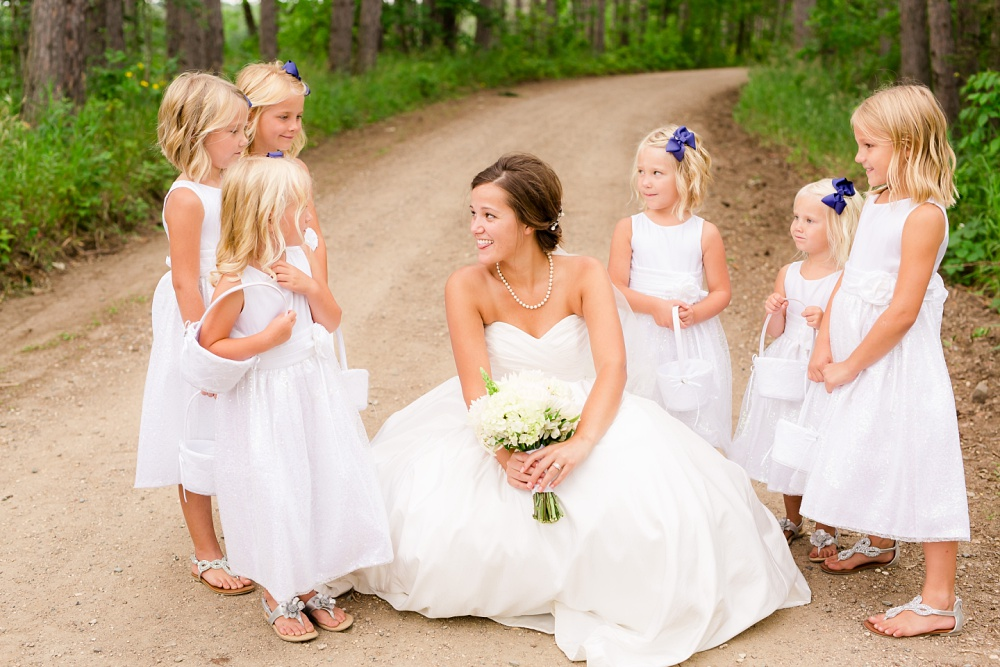 Wolf Lake, MN Country Styled Wedding, White Dress, Blue Suite | Photographed by Amber Langerud Photography | Bride & her flower girls