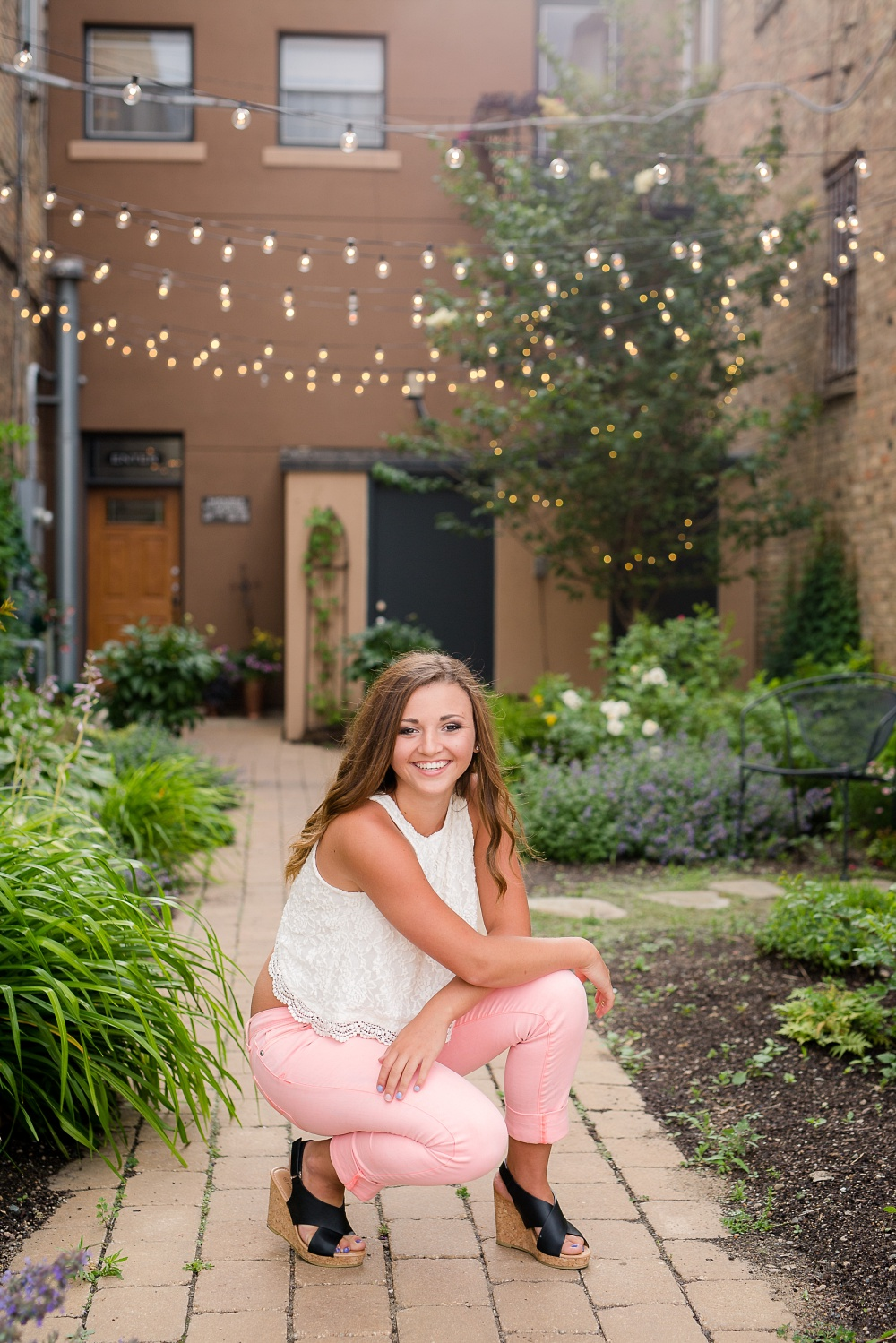 Urban Styled High School Senior Portraits in Detroit Lakes, MN | Photographed by Amber Langerud Photography | Senior Kneeling on Brick Pathway