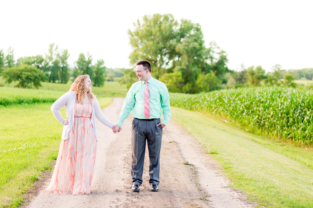 Minnesota Country Styled Engagement Pictures by Amber Langerud Photography | Couple standing on a gravel road