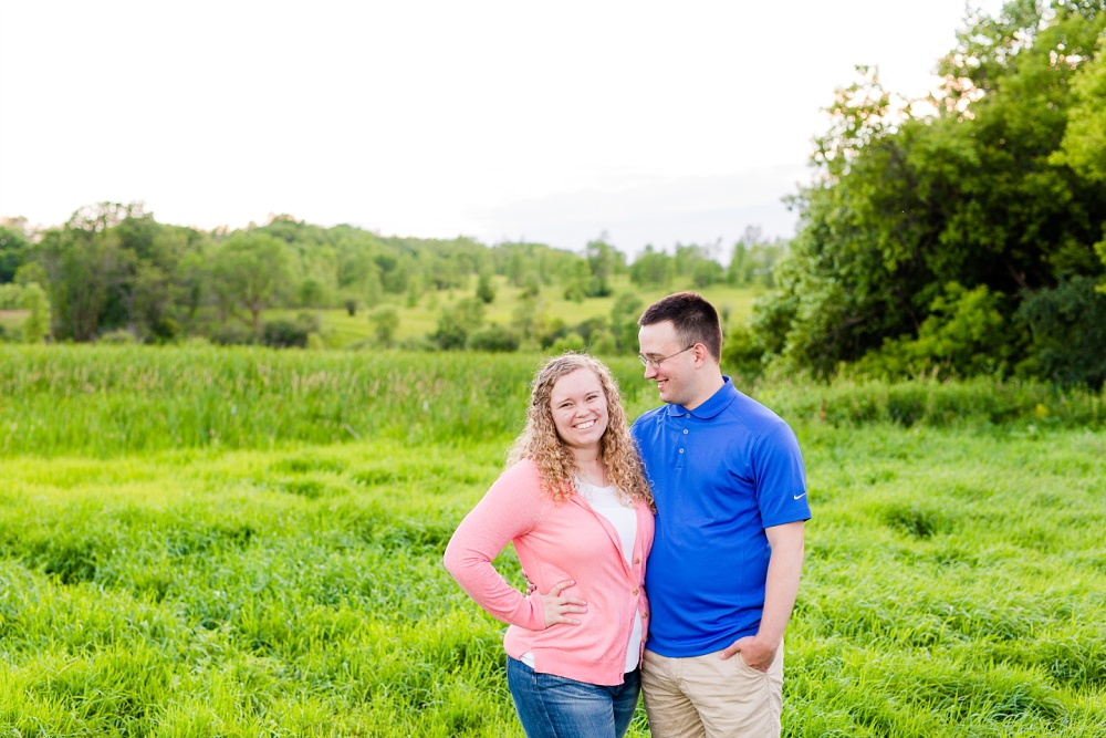 Minnesota Country Styled Engagement Pictures by Amber Langerud Photography | Couple standing in grassy field