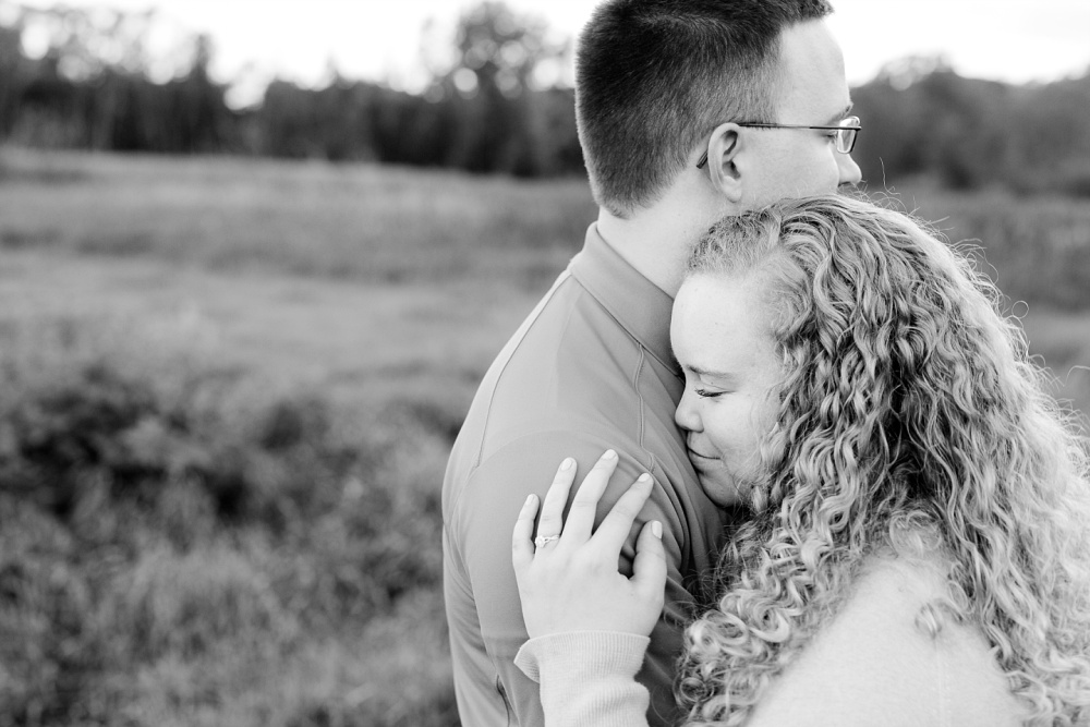 Minnesota Country Styled Engagement Pictures by Amber Langerud Photography | B&W photo of a couple snuggling