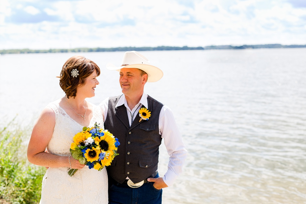 Detroit Lakes, MN Country Styled Wedding at Trinity Lutheran Church & Holmes Ballroom Photographed by Amber Langerud Photography | bride & groom by lake