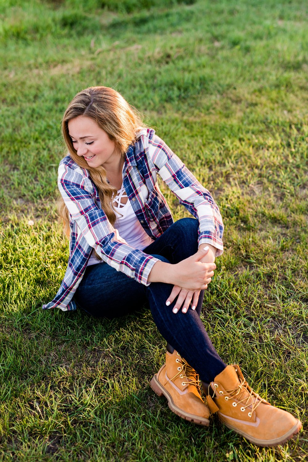 Country Styled High School Senior Pictures on a Farm and Little Cormorant Lake in Minnesota by Amber Langerud with Grass Background