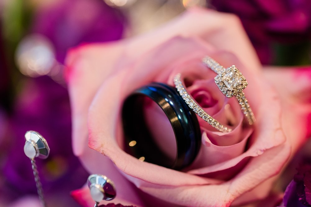 Downtown Fargo Disney Themed Wedding by Amber Langerud Photography | Rings in flowers