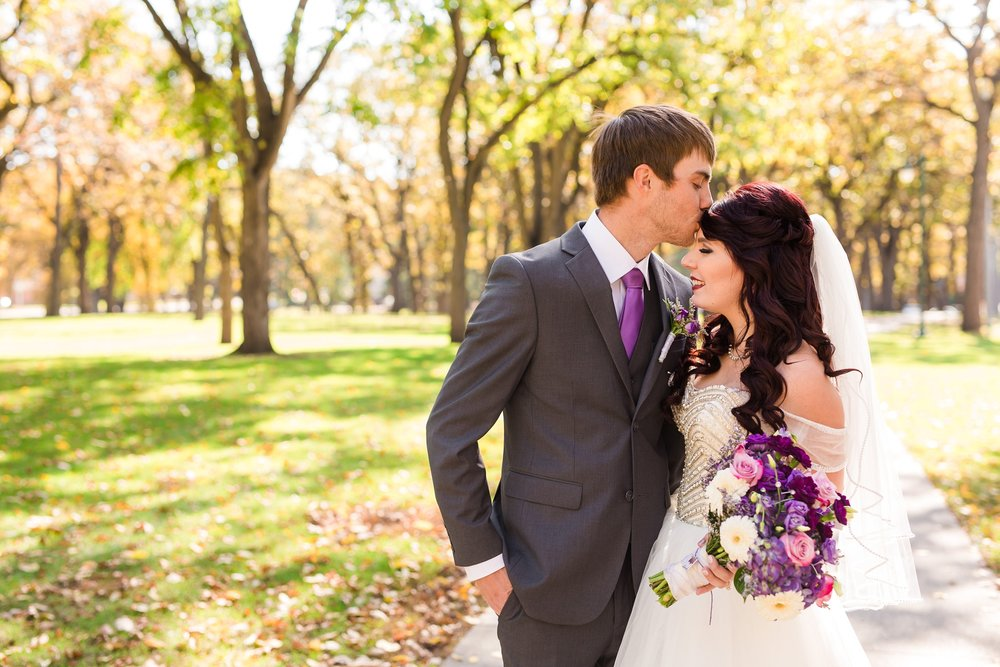 Downtown Fargo Disney Themed Wedding by Amber Langerud Photography | Bride & Groom Portrait Island Park