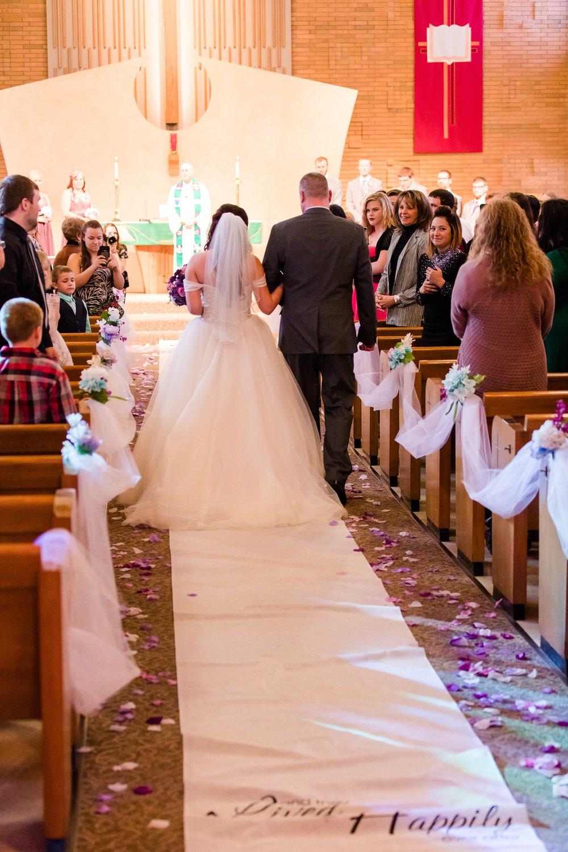 AmberLangerudPhotography_Downtown Fargo, ND Ramada Wedding_3684.jpg