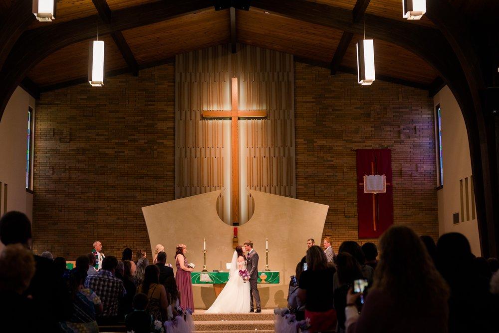 AmberLangerudPhotography_Downtown Fargo, ND Ramada Wedding_3687.jpg