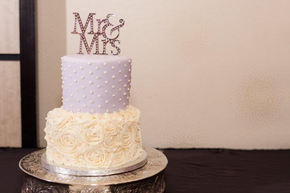 AmberLangerudPhotography_Downtown Fargo, ND Ramada Wedding_3692.jpg