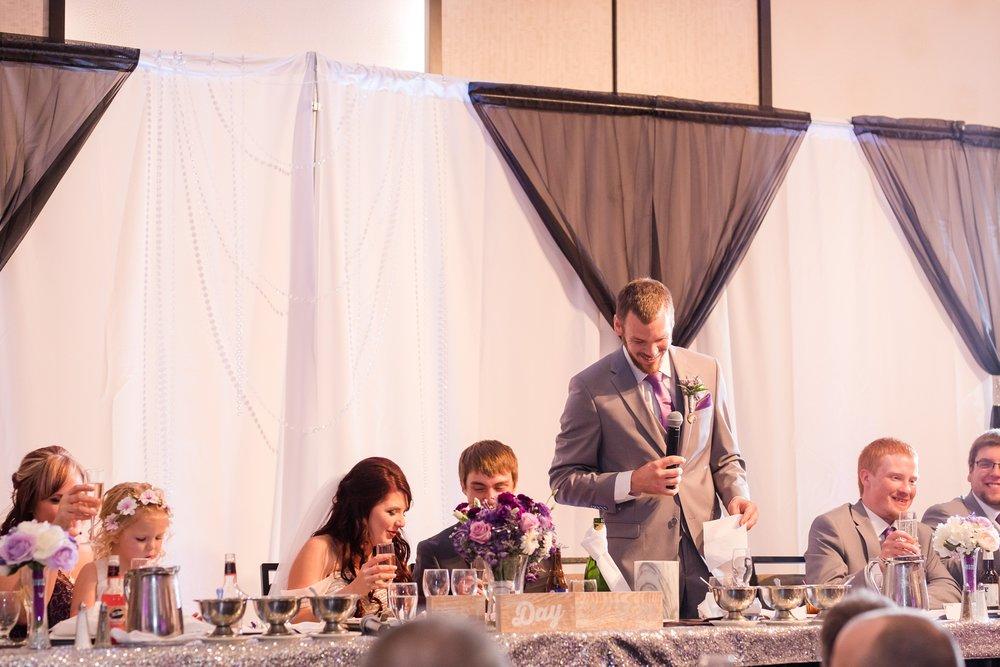 AmberLangerudPhotography_Downtown Fargo, ND Ramada Wedding_3699.jpg