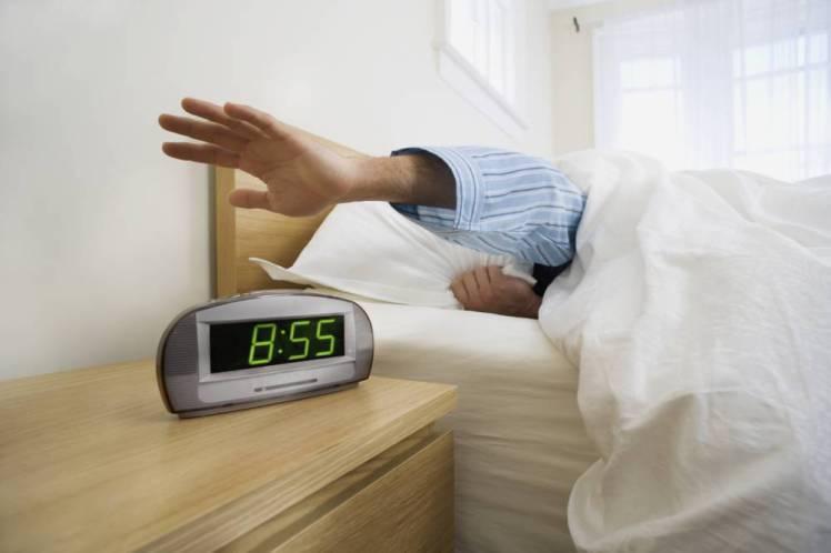 Man Shutting Off Alarm Clock Man Shutting Off Alarm Clock
