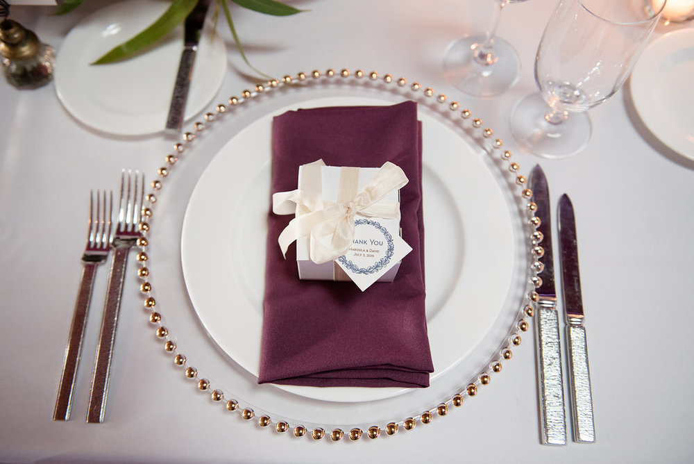 Within Sodo Wedding | Place Setting | Wedding Favor Box | Plum Napkin on Gold Charger | Affinity Photography | Seattle Wedding Planner | New Creations Weddings