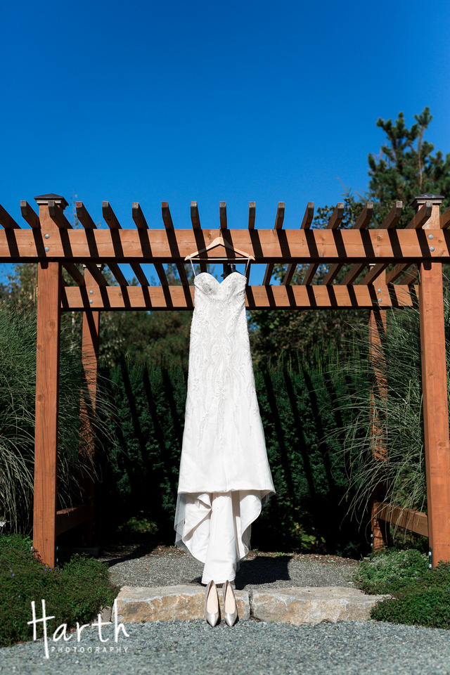Hanging Wedding Gown on Pergola at Willows Lodge