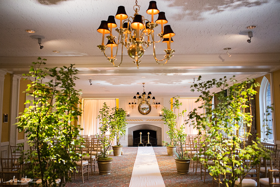Bringing the outdoors in with live trees lining the aisle at the Rainier Club.  An elegant way to dress up any wedding.