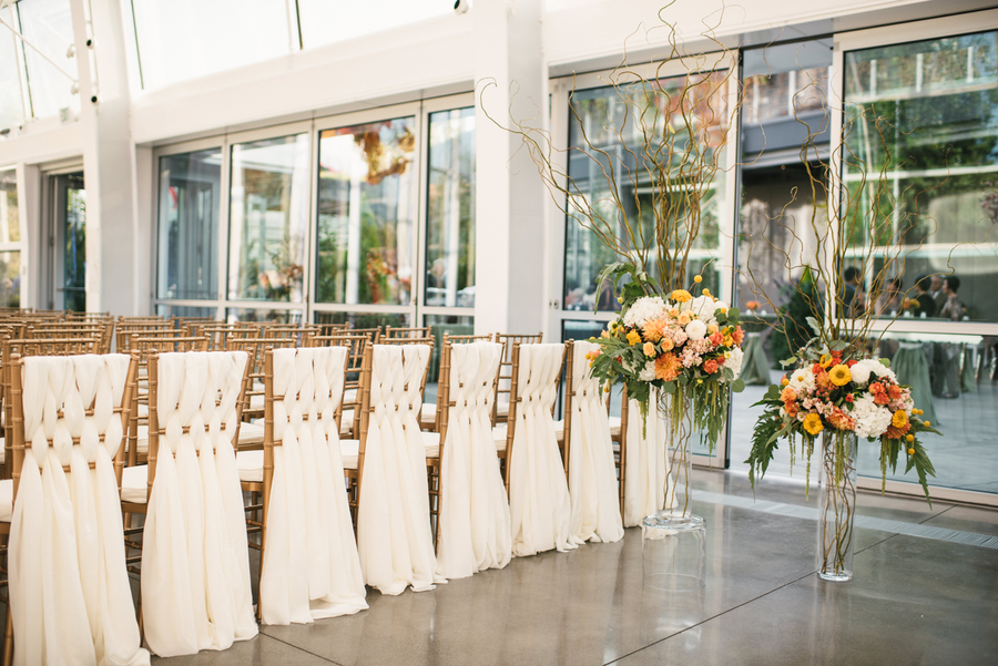 Unique Wedding Chair Ideas.  Woven Sashes on Chivari Chairs along back row of ceremony with tall floral centerpieces.