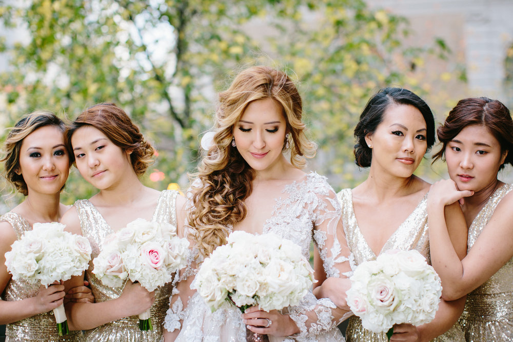 Bridal hairstyle on Korean Bride with white and pink wedding flowers
