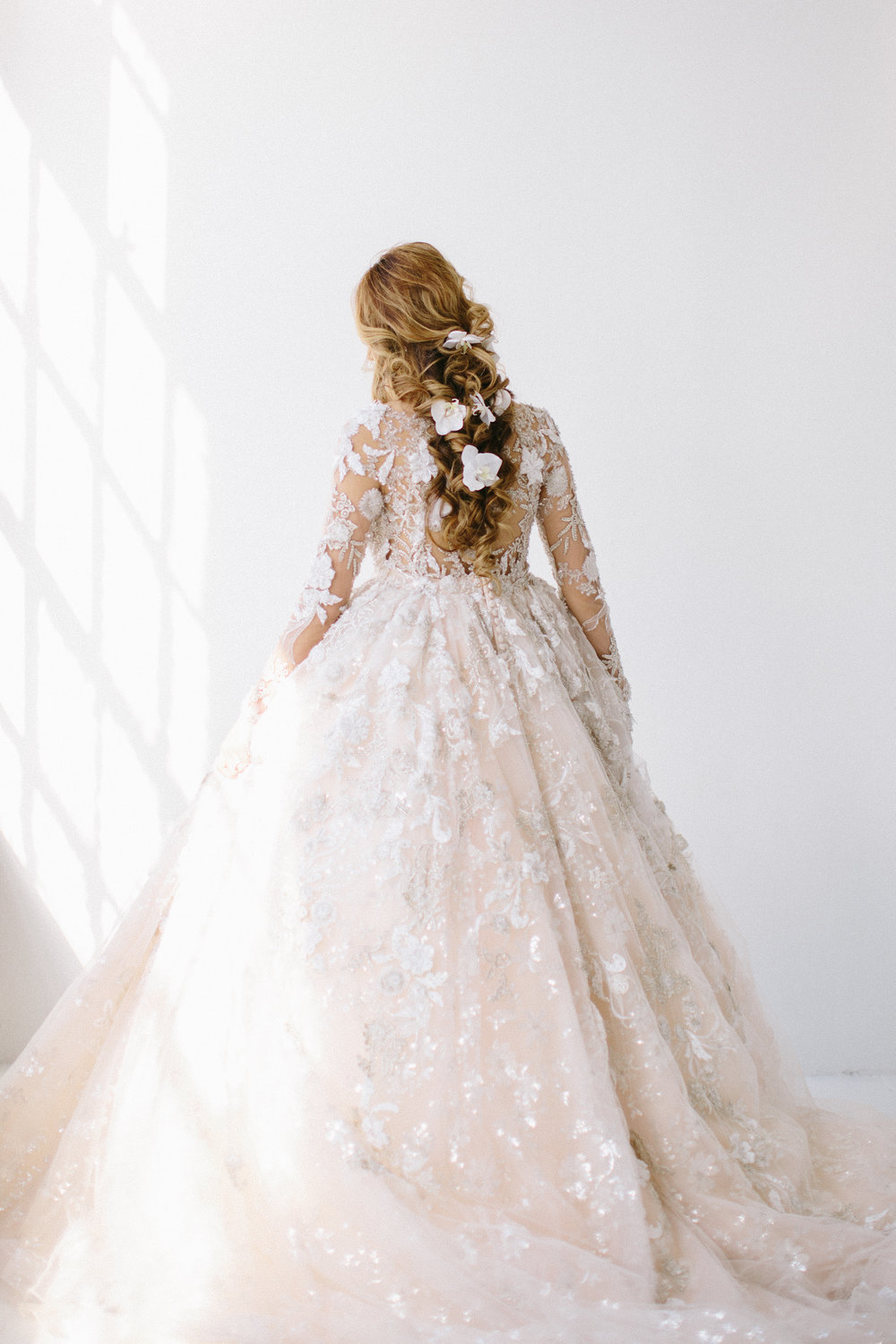Stunning Bridal Hairstyle and Ysa Makino Lace Long-Sleeved Wedding Gown