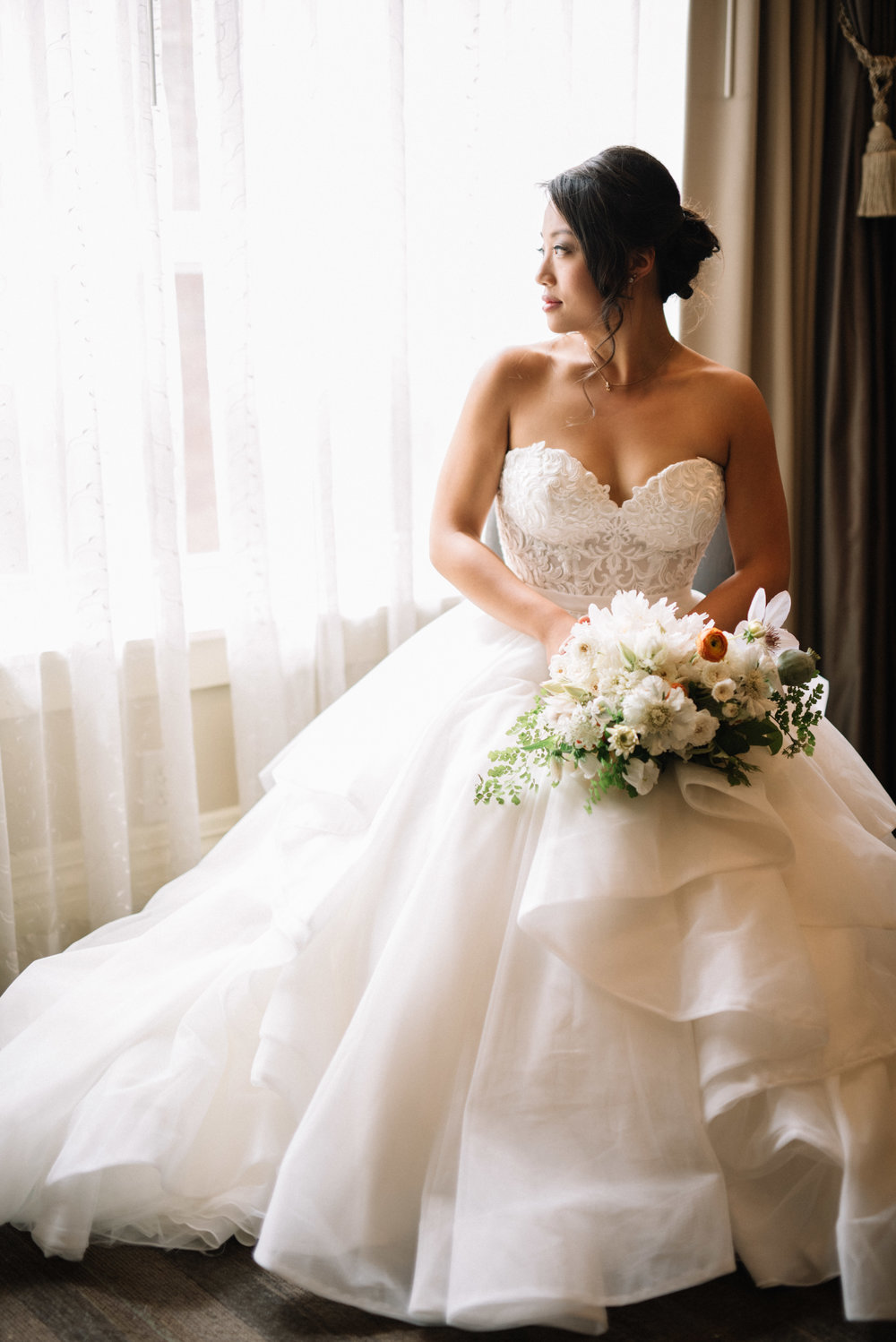 Lace bodice with ruffled skirt wedding gown