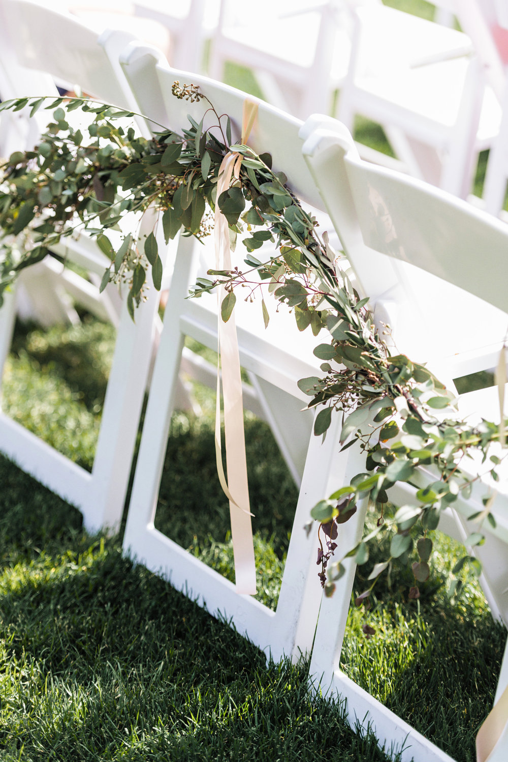 Garland Ceremony Chair Decor at this Garden Style Roche Harbor Wedding Day