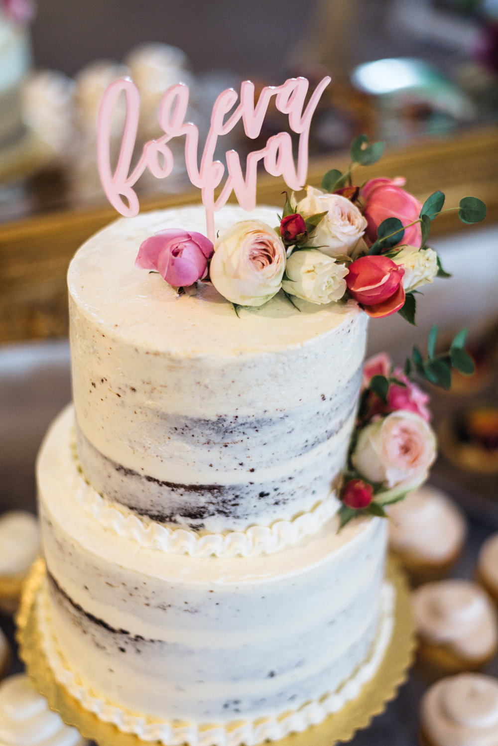 Rustic Naked Cake with Pink Flowers and Unique Cake Topper