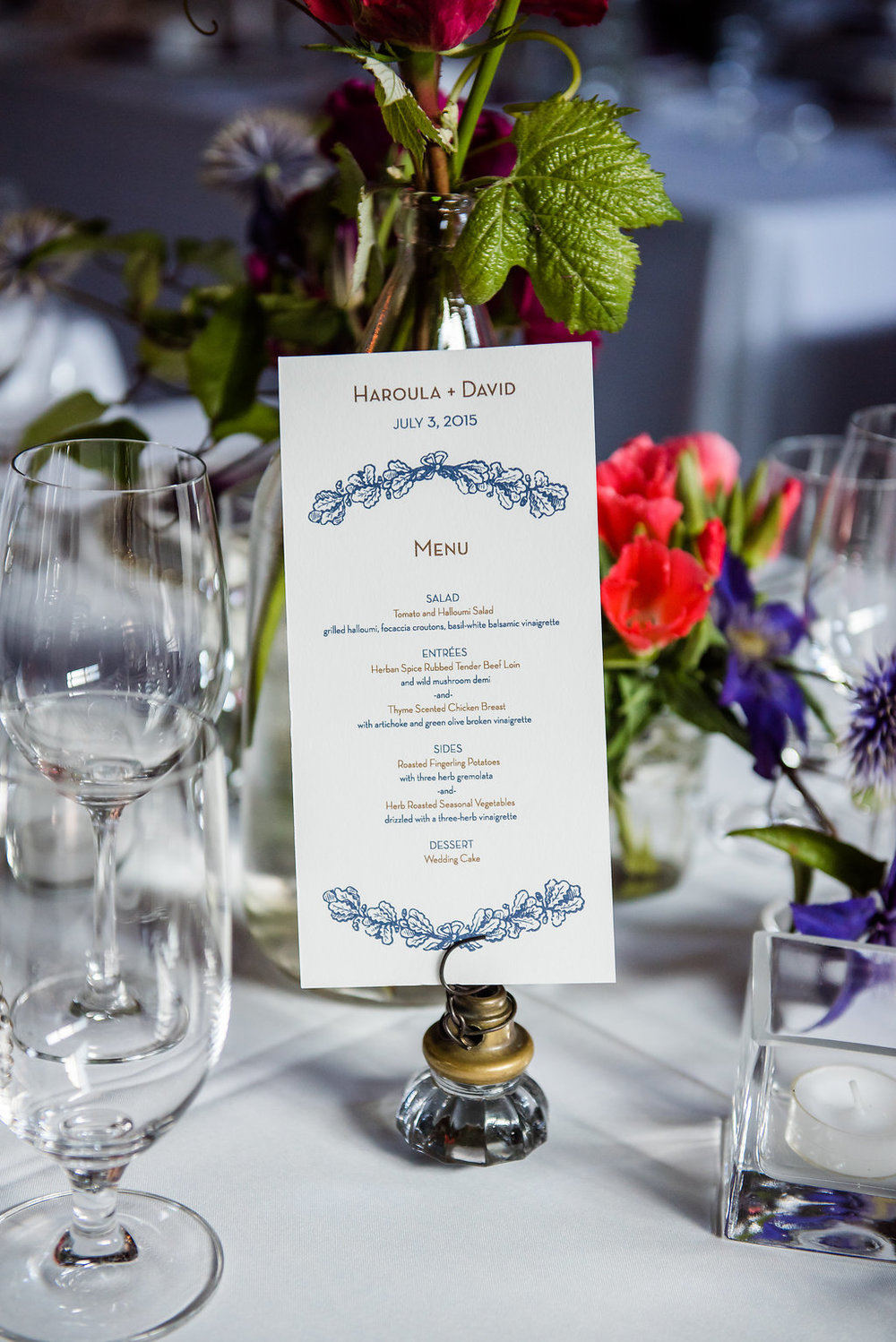 Modern blue and white wedding menu in unique table number holder at this Within Sodo wedding