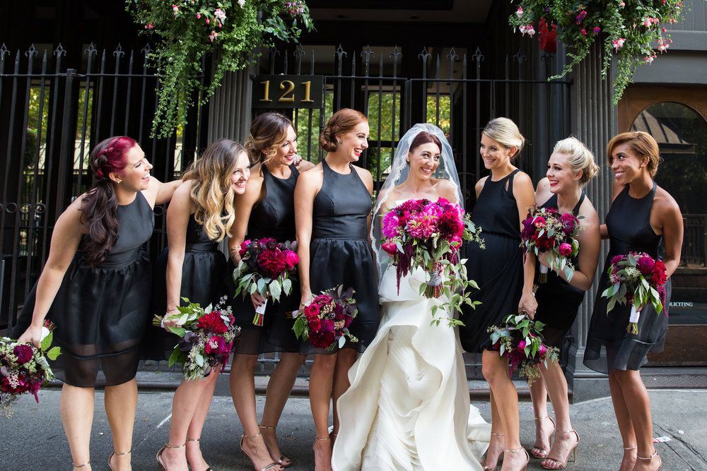 Stunning burgundy and pink bouquets against black bridesmaids dresses at this Axis Pioneer Square Wedding
