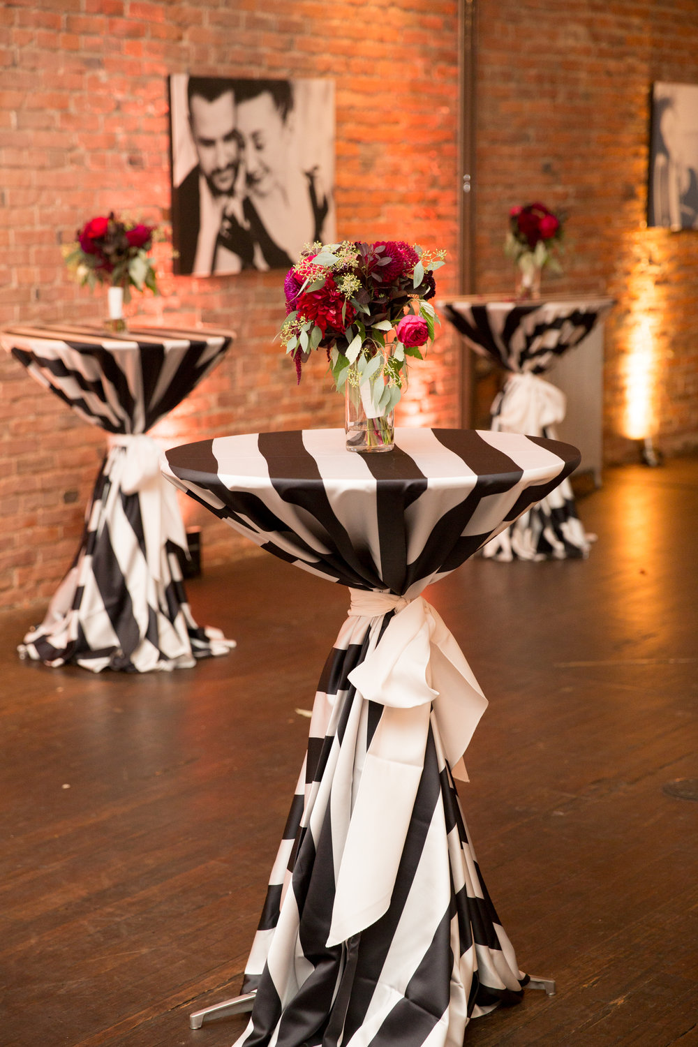 Black and White striped cocktail table linens with burgundy and pink florals