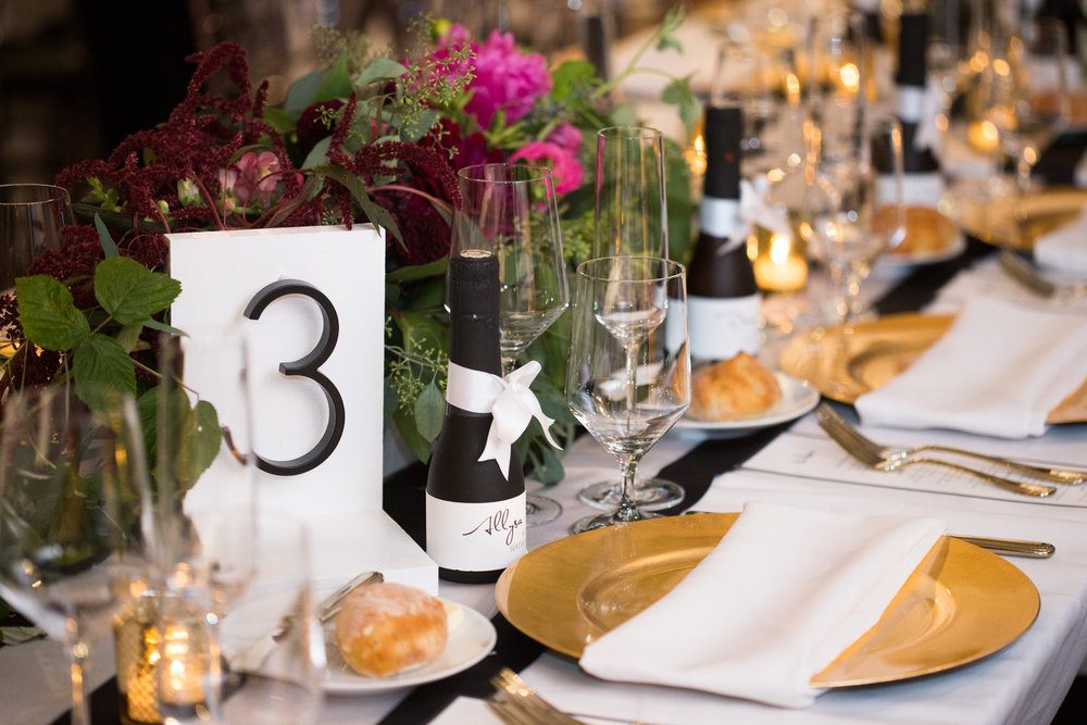Modern Table Numbers with Champagne Bottle Place Cards in this modern Axis Pioneer Square Wedding