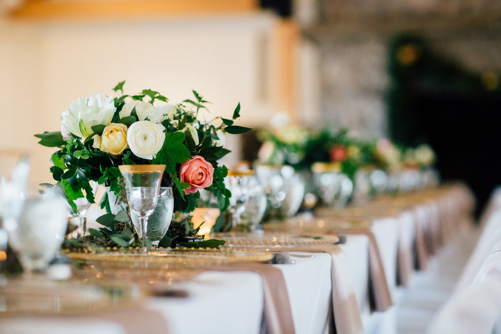 Gold Rimmed Glassware, Gold Beaded Chargers, and Blush Napkins at this Romantic Roche Harbor Wedding