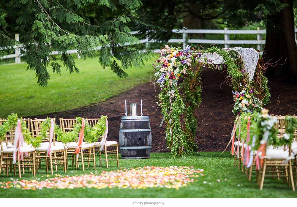Garland Lined Aisle with Stunning Arch at DeLille Cellars