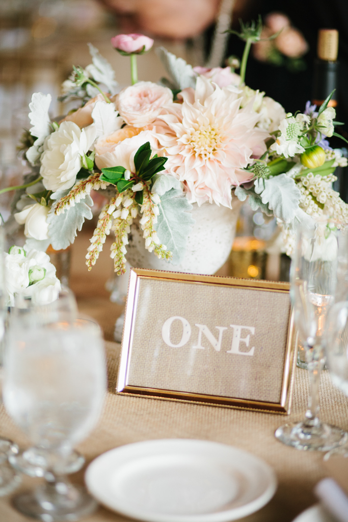 Blush, White and Green Low Wedding Centerpieces with Handmade Table Numbers at this Kiana Lodge Wedding