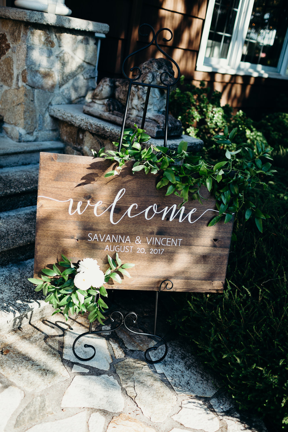 Wood Welcome Sign at Wedding with Greenery