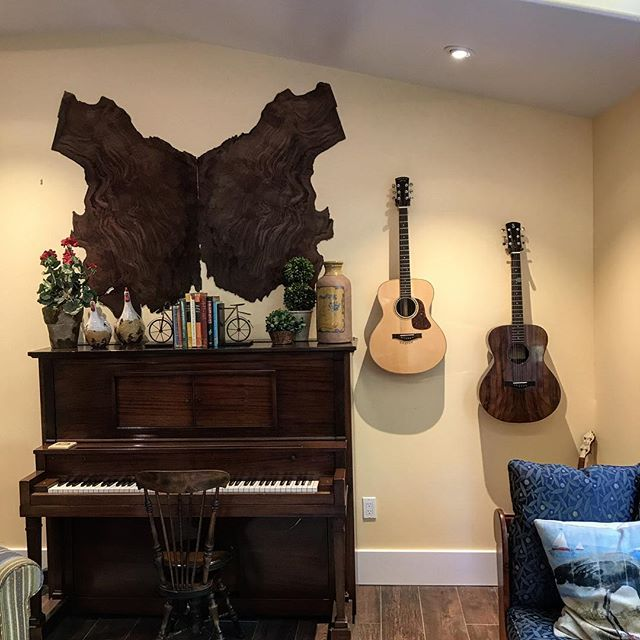 These thin, book-matched slabs of sinker redwood are from the same tree the guitar on the right is made from. It's like a buffalo hide but not!? #guitar #acousticguitar #sinkerredwood #homedecor #music #luthier #luthiery