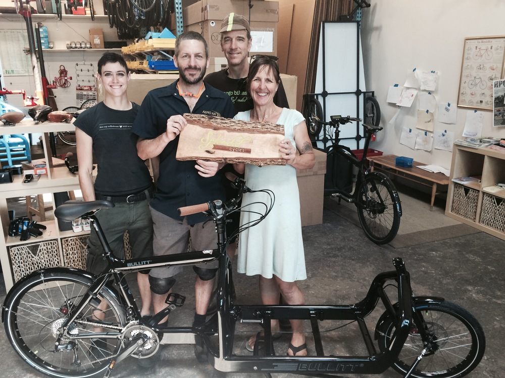 The crew at Splendid Cycles with street librarian Diane Rempe
