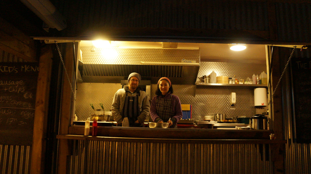 Food stand out the back of the pub. They serve sushi and dumplings! Blackbird Pub.