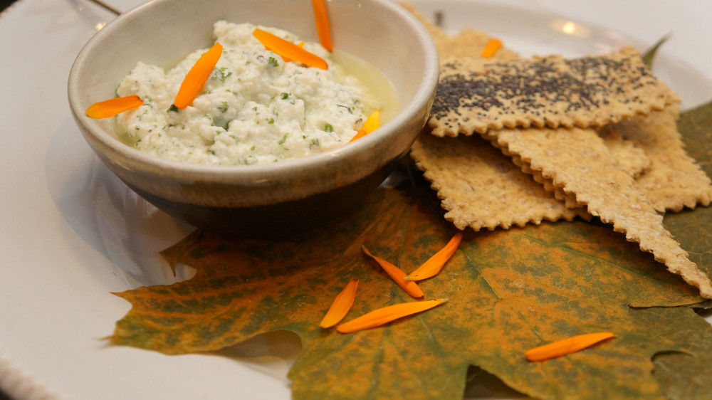 Beautiful ricotta with herb, calendula (an edible flower) and home-made crackers.